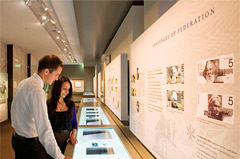 Man and woman looking at historic banknotes in Museum.